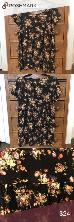 American Apparel Floral Babydoll Dress Floral print short sleeve babydoll dress from American Apparel. Fits loose but is short in length. Could be tucked into jeans as a top or worn as a dress. Soft and comfortable. Preloved xxx American Apparel Dresses Mini
