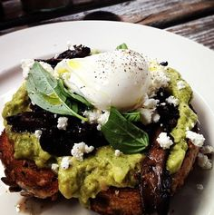 smashed avocado, wild mushrooms and Persian feta on toasted multi-grain bread, topped with poached egg and fresh basil leaves. To die for!!!