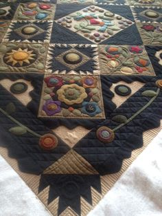 beautiful quilting on a mostly wool quilt