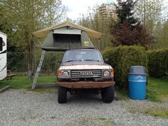 Toyota Landcruiser BJ60 with roof top tent.