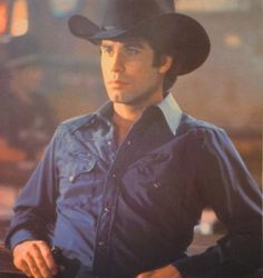 John Travolta as Bud Davis in Urban Cowboy this was when John Travolta was man!