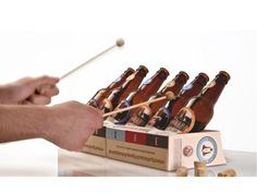 This is a 6-pack that becomes a glass xylophone in an instant. If you use 2 6-packs, then you can get a full octave to play with. Hidden within every 6-pack are two mallets attached to the corks (inside the beer). After drinking your beer to the level indicated on the back (or filling it with water) you can place the bottles into the holder and begin playing. The package can close to become a traditional 6-pack or open, and lay flat, to become a musical instrument The graphics are inspired by...