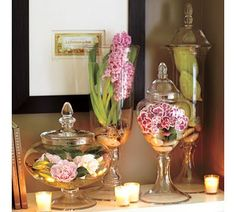 Spring bulbs and flowers anchored with glass marbles.