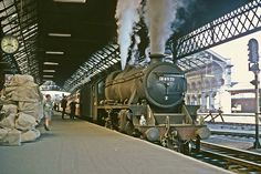 LMS Stanier Class 5 no. 44971 at Preston waiting to depart with the Glasgow - Manchester express. The loco had taken over from at Preston. Steam Trains Uk, Old Steam Train, Diesel Locomotive, Steam Locomotive, Motor A Vapor, Bonde, Steam Railway, Electric, Old Trains