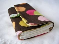 pocket tissue holder...I like this one because it's not just for the mini packs, it's made to put folded tissues in.