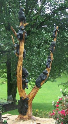 Bears up a Tree.Carved from wood