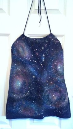 DIY galaxy t-shirt (dk blue). Link to helpful tutorial: http://www.autostraddle.com/how-to-own-it-the-queer-grrls-guide-to-the-galaxy-149697/  I used 50/50 bleach and water to spray spots, then washed and dried. I sponge painted the colors on with acrylic paint MIXED with Folk Art Textile Medium to use on fabric!! Stars speckled on with a toothbrush and some hand painted with a small brush. I used the toothbrush also for blending; scrub to get the glowing effect and make glowing larger…