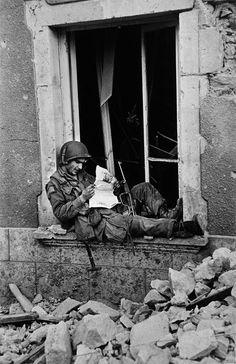""" An American soldier in Saint-Sauveur-le-Vicomte, France - 16 June 1944. Photo by Robert Capa. """