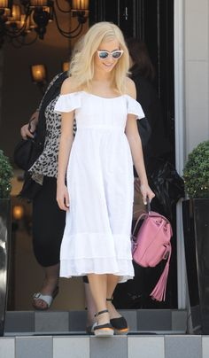 Pixie Lott looks perfectly casual in her white, off-shoulder prairie dress, which so happens to be having a moment: http://asos.do/amjN0I