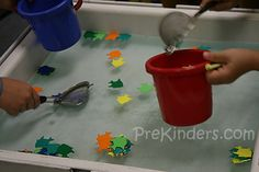 Children use kitchen strainers to catch the fish in the water. I purchased a small package of foam fish at a craft store for about $2. If foam fish aren't available, you can use any foam shape or cut fish from sheets of craft foam. They used the buckets to collect the fish they caught.