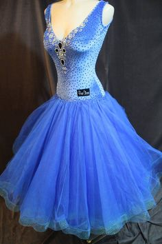 Brand new Pure Class brand blue ballroom dress. Bodice covered in Swarovski stones of multiple sizes with deep V neckline. Open, rounded back with buttons up the back of the dress along the waist. Full tulle skirt with horsehair around hemline. Size adult small. $2500 USD or best offer.