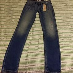 Levi's Skinny Jean's Levi's 524 Skinny Jeans * New Never Worn * Low Rise Skinny Jean. Distressed look on the front. Medium Length Jean Very Tight Fit. Soft Denim. Levi's Jeans Skinny