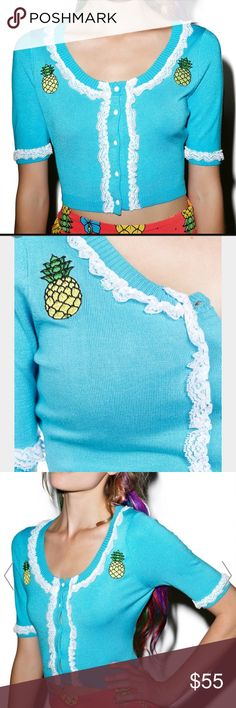 Pina Colada Retro Cardigan Sourpuss Clothing Bella Pina Colada Cardigan cuz there's no better piece to show off yer perfect pineapples, bb! Knock their socks off in this adorable retro-inspired cropped cardigan, featuring a bright turquoise stretch knit construction, deep scoop neckline, delicate white lace trim all over the chest and sleeves, pineapples embroidered on the chest, and button front closure.   BLUE Materials: 72% Viscose, 28% Nylon Machine Wash Cold, Hang Dry Our Doll wears S…