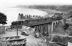 """""""Can't you just imagine the excitement of arriving at your holiday destination by This photograph is of Situated immediately outside the station was Sandsend Viaduct which must have resulted in numerous dramatic images like this one. Scale Model Architecture, Disused Stations, Northern England, Train Pictures, British Rail, Train Journey, Water Tower, North Yorkshire, Train Travel"""