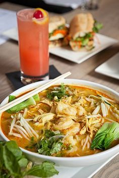 Curry Laksa - one of our most popular dishes. Shrimp, shredded chicken, baby bok choy, and fresh herbs served in a spicy coconut broth...goes great with a Singapore Sling! #Repin if you'd love to try this dish! #EatAtCO