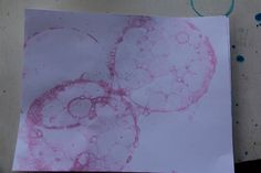 Bubble Prints - using bubble solution, food coloring, and a slitted straw for blowing.