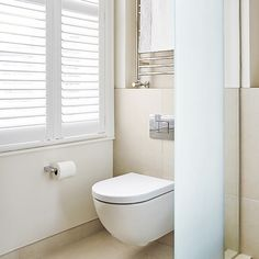 Plain white bathroom with wall-hung loo