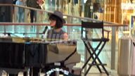 VIDEO Delta Goodrem in disguise while busking to promote her new single