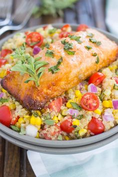 This Honey Garlic Salmon Quinoa Bowl is a flavorful and delicious, protein-packed meal. It's filled with hearty quinoa, fresh corn, cherry tomatoes, and herbs. Tossed in a simple, white balsamic dressing and served with salmon seasoned with a honey garlic sauce, this easy dish is ready in just 30 minutes and full of flavor!