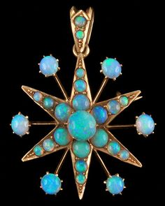 Australian opal star | The setting doesn't really do it for me, but the stones are fabulous.