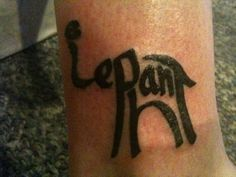 """Elephant tattoo. But it's made out of the word """"elephant""""."""