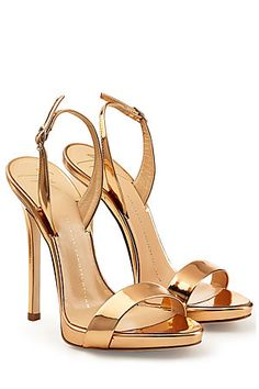 An eye-catching alternative to nude, Giuseppe Zanotti's mirrored sandals feature extra flattering wafer platforms and patent leather metallic uppers #Stylebop