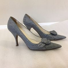 """PRADA denim blue pointed pumps, size 40, Italy Very Audrey Hepburn and so mid-century modern PRADA denim blue textured pointed toe pumps with leather rose bud accent. In preowned condition with some wear at toe.  Made in Italy, marked size 40, approx 4"""" heels. Please ask questions prior to purchase. 🚫Trades. Reasonable offers only. Prada Shoes Heels"""