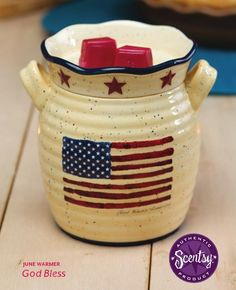 """God Bless"" - June 2013 Warmer of the Month: God Bless proudly waves the good ol' red, white, and blue on a weathered cream background while rustic red stars encircle the warmer dish. Add a nice touch of Americana to your home.  Available June 1, 2013 Reg 35.00 Now 31.50 (10% OFF)"