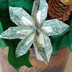 Unique origami money flower DIY gift idea + 11 other DIY gifts - money is a gift most people would love to receive! Make these fun flowers and place them in an arrangement for a pretty gift!