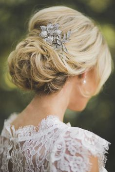 romantic messy mass of loose curls wedding updo with antique hair comb