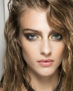 One for the rock n' roll bride - go for dramatic black and gold smokey eyes and tousled hair for an effortlessly cool wedding make-up look.