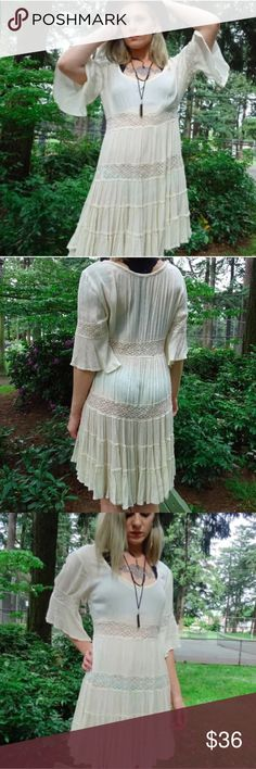 Free People Cream Festival Dress Free People cream lace crotchet stripe bell sleeve, scoop neck dress. Cotton. Easy fit pullover construction. Sheer. Size S, but could fit medium. All photos taken by me, and feature actual physical item. All jewelry in pictures handmade in Portland, OR by Raspy Timbre. Free People Dresses Mini