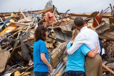 President Barack Obama hugs Amy Simpson, principal of Plaza Towers Elementary School, outside what remains of the school following a tornado in Moore, Oklahoma, on May 26, 2013.