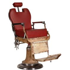 These sorts of chairs were used when curls were made with hot irons and men went to the barbers to be shaved with straight-edge razors. Today, the swivelling FIGARO hairdressers' chair with its red artificial leather seat, neck support and foot rest seems quite eccentric. Vintage look.