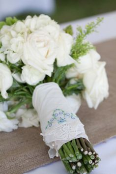 Perfect way to use her baptism bonnet as her something old:) Use vintage hankies to wrap around flower stems or burlap and lace.