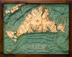 """Martha's Vineyard (16 x 20) is an island located south of Cape Cod in Massachusetts, known for being an affluent summer colony. Often called just """"The Vineyard,"""" the island has a land area of 100 square miles. This chart is solid wood framed, crystal clear acrylic covered, 3- Dimensional, bathymetric chart carved in Baltic Birch wood. Intricate detail is carved and laser etched creating a unique & accurate artwork."""