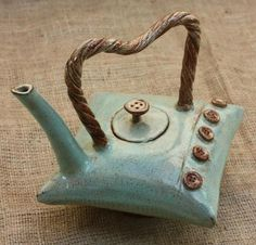 What a quirky and interesting looking Pot! What would be your favourite Tea to have inside?