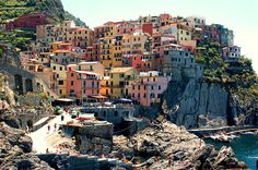 Cinque Terre, Italy-The Cinque Terre is part of the coast in the Liguria region of Italy. The terraces built on the rugged landscape are a popular tourist attraction.