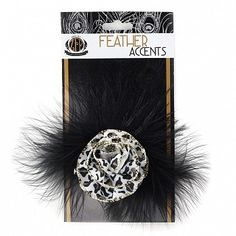"""Marabou Ostrich Feather Clip w/Ribbon Black/Silver/White Product SKU: FCMO--BL-SLV-W Size: 5.5"""" diameter (with clip) Shop Feathers: www.featherplace.com SUGGESTED USES: Feather pins, clips, corsages are trims can be worn on garments, coats, jackets, hats, hair and headband accessories, purse clips, shoe clips, flip flop clips, and more. Depending on the design, these items make great boutonnieres and can even be used as feather gift wrap embellishments, or party favors."""