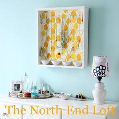 The North End Loft: DIY Jewelry Organizer. Make a jewelry organizer from an old drawer- paint it, put fabric or other design on the inside. Attach cup hooks to hold necklaces, bracelets, earrings. Glue small bowls to the bottom to hold rings, etc.