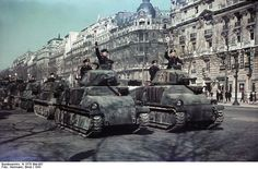 Parade of German Panzerkampfwagen 35S 739(f) in the street of Champs-Elysées, Paris, 1 January 1941. This ex-French tanks formerly known as Somua-S-35 and Hotchkiss H 38. Photo by Ernst Herrmann