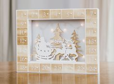 Christmas Advent LED Light Up Calendar, White and Natural: Amazon.co.uk: Kitchen & Home