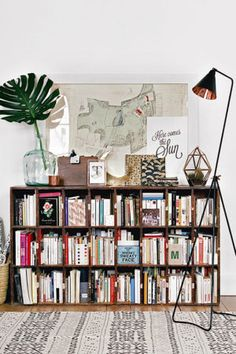 Decorating a bookshelf can require a lot of time, dedication, and a ton of beautiful objects. Take bookshelf styling inspiration for your own at home library from these popular interior designers.
