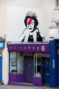 Banksy's tribute to the Queen's Diamond Jubilee celebrations - a graffiti stencil of Her Majesty as Bowie's Aladdin Sane. Bristol, England 2012.