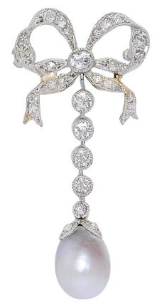 A Belle Époque Natural Pearl and Diamond Bow Brooch, circa 1910  The small ribbon bow decorated with old mine-cut diamonds, to a line of diamond collets suspending a natural pearl measuring approximately 11.2 mm by 8.6 mm, mounted in platinum