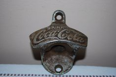 Want :-) Antique Coca Cola Wall Mounted Bottle by AGlimpseFromthePast via Etsy