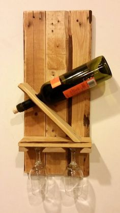 Weathered Wine Rack For Two Weathered wood has always held a certain rustic beauty. Wooden pallets are strong and durable.  Each has a mysterious history.  Where have they travelled?  What have they held?  Who did they belong to?  We have taken a seasoned pallet and transformed it into an artistically beautiful wine rack for two. It is a great conversation starter!  This Weathered Wine Rack For Two is designed to hold a single wine bottle and two wine glasses.  Hanging hardware attached.