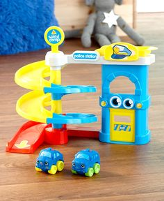 Your little one will get a kick out of feeling like an everyday hero with this Fire Station or Police Playset. It comes with 2 soft, squeezable cars that are a