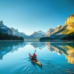 Paddling into the silence ✨❤️✨ Maligne Lake, Alberta - Canada. Picture by ✨✨@ChrisBurkard✨✨