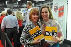 Showing off their advanced copies of HOLD.